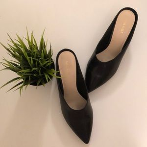 Black heeled mules by Nine West in size 10